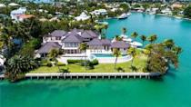 """<p>At the top of the list is this jaw-dropping Florida mansion, which was designed by renowned architect Charles Pawley. With six sprawling <a href=""""https://www.housebeautiful.com/uk/decorate/bedroom/a35432588/feng-shui-bedroom/"""" rel=""""nofollow noopener"""" target=""""_blank"""" data-ylk=""""slk:bedrooms"""" class=""""link rapid-noclick-resp"""">bedrooms</a>, breathtaking sea views, a home theatre, office, waterfront summer kitchen, and a gated entrance, it really is no surprise it took the first spot. Why not take a tour...</p><p><a href=""""https://www.rightmove.co.uk/properties/71721736#/"""" rel=""""nofollow noopener"""" target=""""_blank"""" data-ylk=""""slk:This property is currently on the market for £16,504,946 with Savills via Rightmove."""" class=""""link rapid-noclick-resp"""">This property is currently on the market for £16,504,946 with Savills via Rightmove.</a><br></p>"""