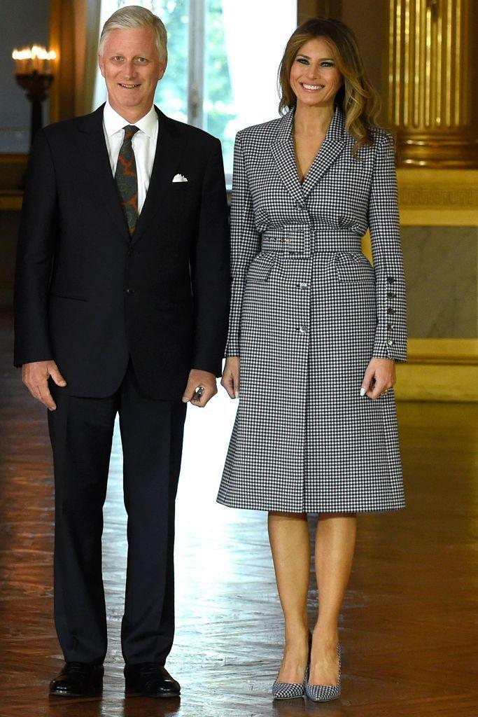 <p>For her meeting with the King and Queen of Belgium, the First Lady wore a Michael Kors collection ensemble: a gingham suit dress and matching gingham Manolo Blahnik pumps.</p>