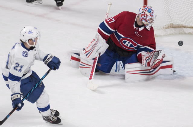 Tampa Bay Lightning center Brayden Point (21) scores against Montreal Canadiens goaltender Antti Niemi (37) during a shootout of NHL hockey game action in Montreal, Saturday, Feb. 24, 2018. (Graham Hughes/The Canadian Press via AP)