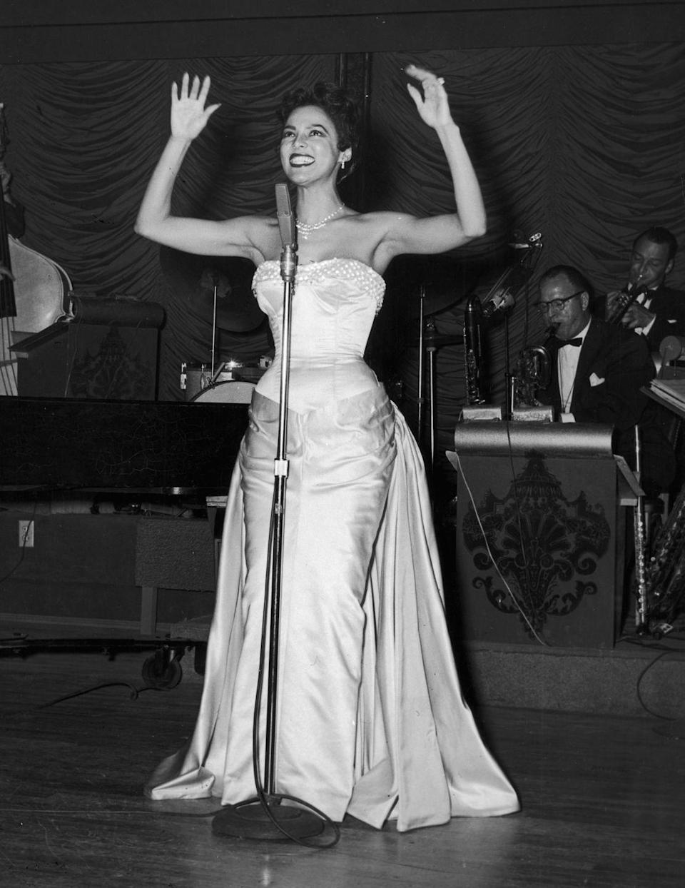 """<p>After a brief hiatus from performing, Dandridge embarked on a solo singing career and became a regular on the nightclub circuit, including at the <a href=""""https://www.britannica.com/biography/Dorothy-Dandridge"""" rel=""""nofollow noopener"""" target=""""_blank"""" data-ylk=""""slk:Waldorf Astoria's Empire Room"""" class=""""link rapid-noclick-resp"""">Waldorf Astoria's Empire Room</a>.</p>"""