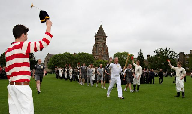 In this handout image provided by LOCOG, Torchbearer 027 John Richards carries the Olympic Flame around the grounds of Rugby School during day 45 of the Olympic Flame Torch Relay on July 2, 2012 in Rugby, England. The Olympic Flame is now on day 45 of a 70-day relay involving 8,000 torchbearers covering 8,000 miles. (Photo by LOCOG via Getty Images)