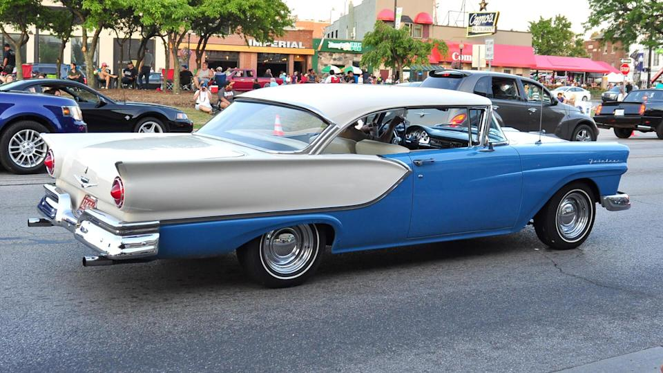 Ferndale, MI/USA-August 15 2015: 1957 Ford Fairlane car, back view, cruising the streets at the annual Woodward Dream Cruise; male driver.