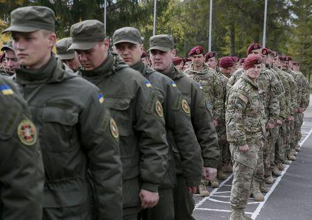 "Servicemen of 173rd Airborne Brigade Combat Team of the U.S. Army and Ukrainian National Guard attend an opening ceremony of joint military exercise ""Fearless Guardian 2015"" at the International Peacekeeping Security Center near the village of Starychy"
