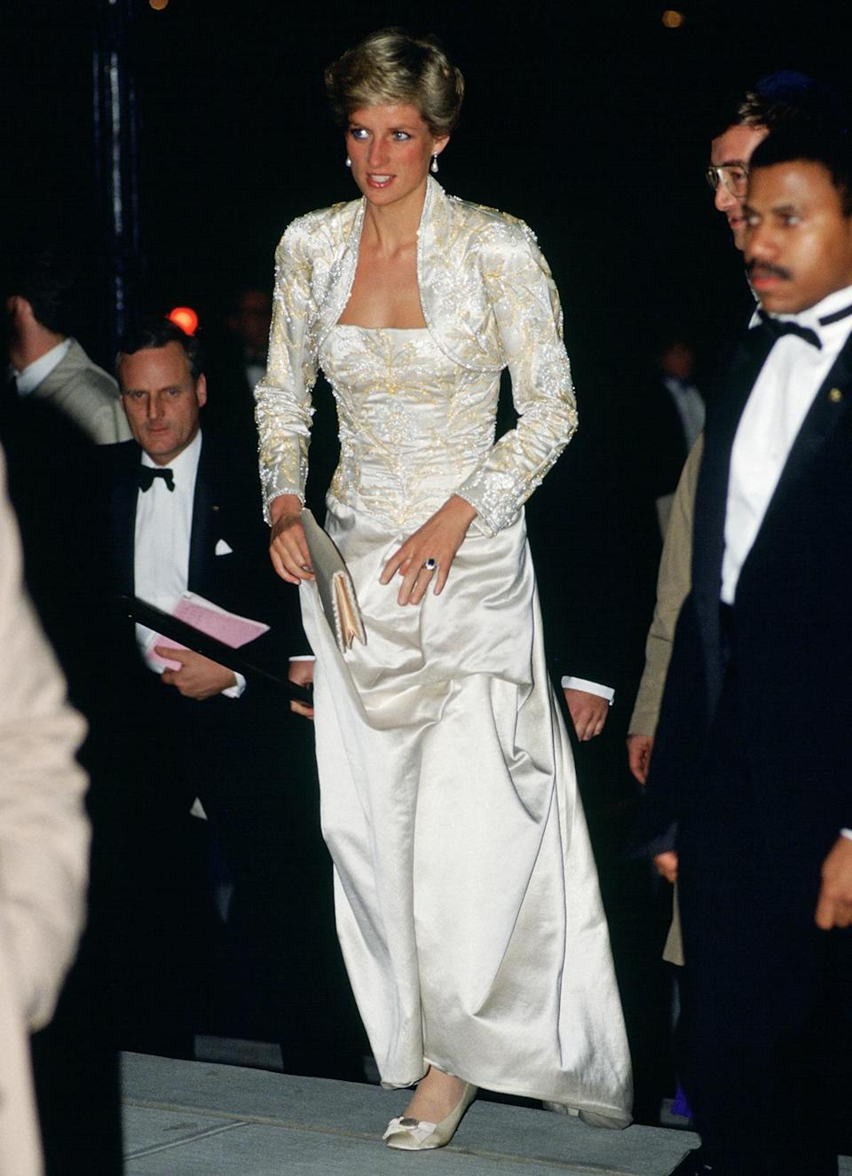 """<p>""""When Diana entered the box, radiant in a magnificent long white dress with a matching bolero jacket covered in jewels, a gasp went up from the crowd,"""" Karen Brooks Hopkins, President Emerita of BAM, told PEOPLE of <a href=""""https://people.com/royals/princess-diana-new-york-city-opera-night-recreated-the-crown-first-hand-account/"""" rel=""""nofollow noopener"""" target=""""_blank"""" data-ylk=""""slk:Princess Diana's 1989 trip to the opera"""" class=""""link rapid-noclick-resp"""">Princess Diana's 1989 trip to the opera</a> while visiting N.Y.C. in 1989. </p>"""