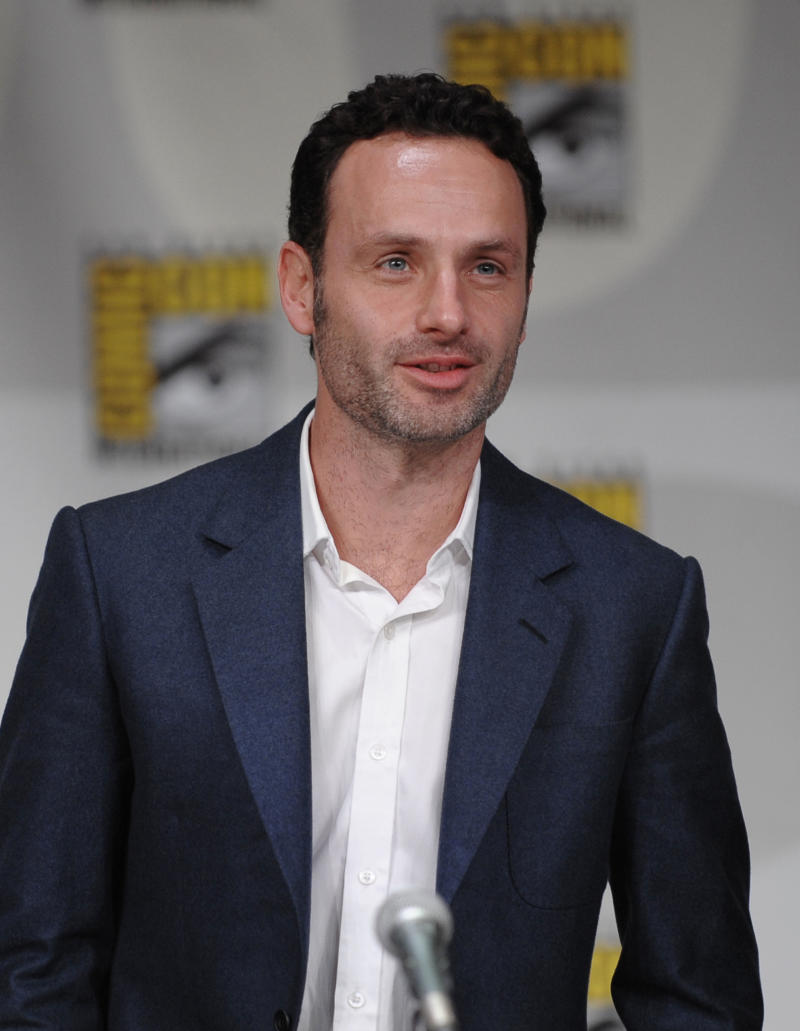"""FILE - In this July 22, 2011 file photo, actor Andrew Lincoln waves to the crowd as he arrives for at a panel for the television series """"The Walking Dead"""" at the Comic-Con International 2011 convention held in San Diego. The series airs Sunday at 9p.m. EST on AMC.(AP Photo/Denis Poroy, file)"""