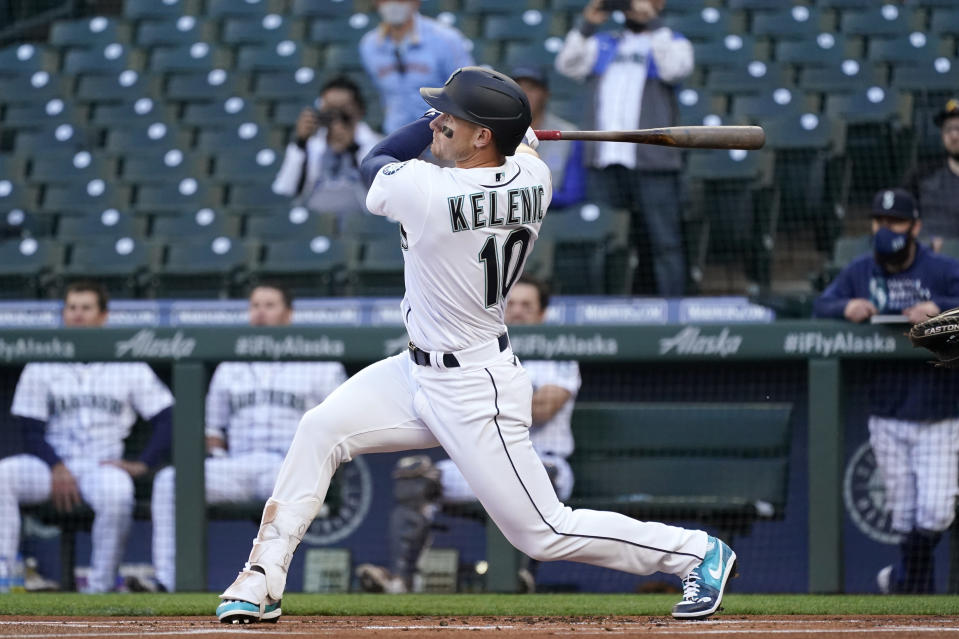 Seattle Mariners' Jarred Kelenic watches his foul ball in his first major league at-bat, in the first inning of the team's baseball game against the Cleveland Indians on Thursday, May 13, 2021, in Seattle. Kelenic flied out on the at-bat. (AP Photo/Elaine Thompson)
