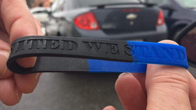 'Take a step back': Wristbands supporting charged officer shouldn't be worn on duty, leaders say