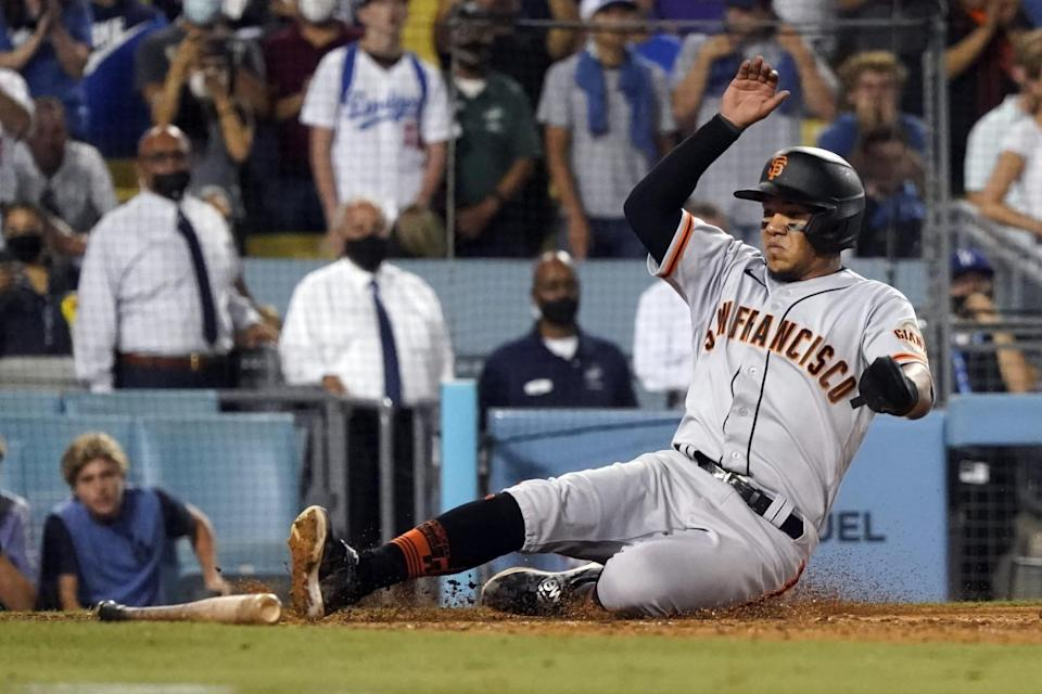 The Giants' Thairo Estrada scores on a single by LaMonte Wade Jr. in the ninth inning Thursday.