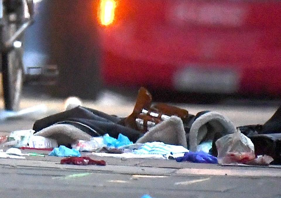 Items left on the pavement at the scene in Streatham High Road, south London (Victoria Jones/PA) (PA Archive)