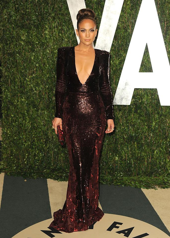 "Jennifer Lopez turned heads on the Oscars red carpet in a plunging,  silver Zuhair Murad gown, but the diva extraordinaire looked even better  at the annual Vanity Fair afterparty in yet another revealing Murad  masterpiece. Luckily -- at the post-ceremony soiree -- J.Lo didn't  suffer a second slip. <a target=""_blank"" href=""http://movies.yahoo.com/blogs/oscars/jennifer-lopez-oscars-wardrobe-malfunction-did-her-dress-031227699.html"">Her first frock may have showcased a bit too much skin</a>, but her encore ensemble was utter perfection."