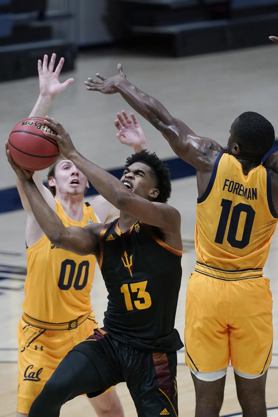 Arizona State guard Josh Christopher (13) shoots between California guards Ryan Betley (00) and Makale Foreman (10) during the first half of an NCAA college basketball game in Berkeley, Calif., Thursday, Dec. 3, 2020. (AP Photo/Jeff Chiu)