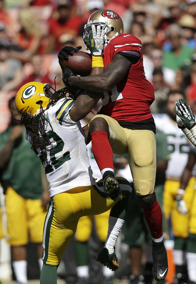 San Francisco 49ers wide receiver Anquan Boldin catches a pass over Green Bay Packers defensive back Jerron McMillian (22) during the second quarter of an NFL football game in San Francisco, Sunday, Sept. 8, 2013. (AP Photo/Marcio Jose Sanchez)