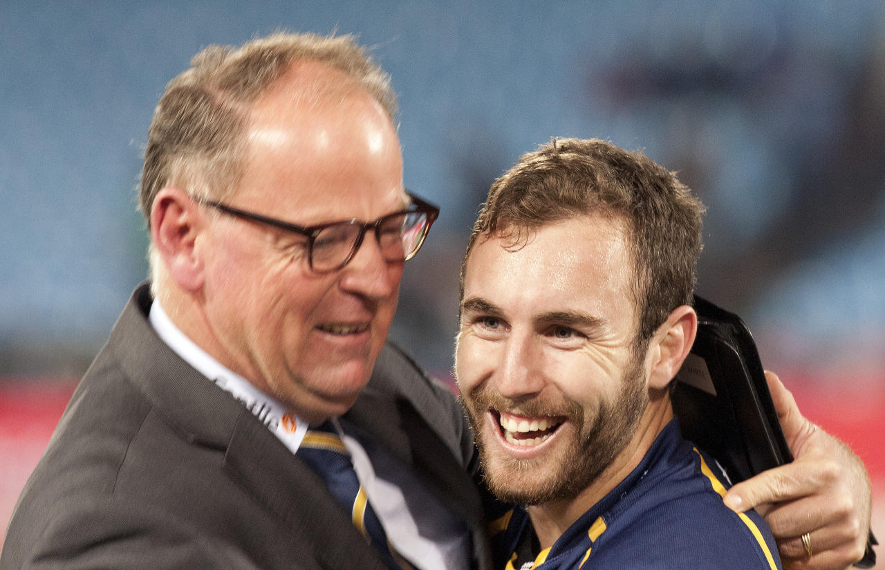 Australia's Brumbies Nic White, right, celebrates with coach Jake White, left, at the end of their Super Rugby semi final match against South Africa's Bulls at Loftus Versfeld Stadium in Pretoria, South Africa, Saturday July 27, 2013. Brumbies beat Bulls 26-23. (AP Photo/Themba Hadebe)