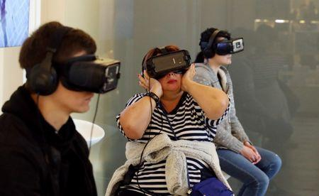 Visitors use VR headsets at the State Hermitage Museum in Saint Petersburg, Russia, July 1, 2018. REUTERS/Mariana Bazo