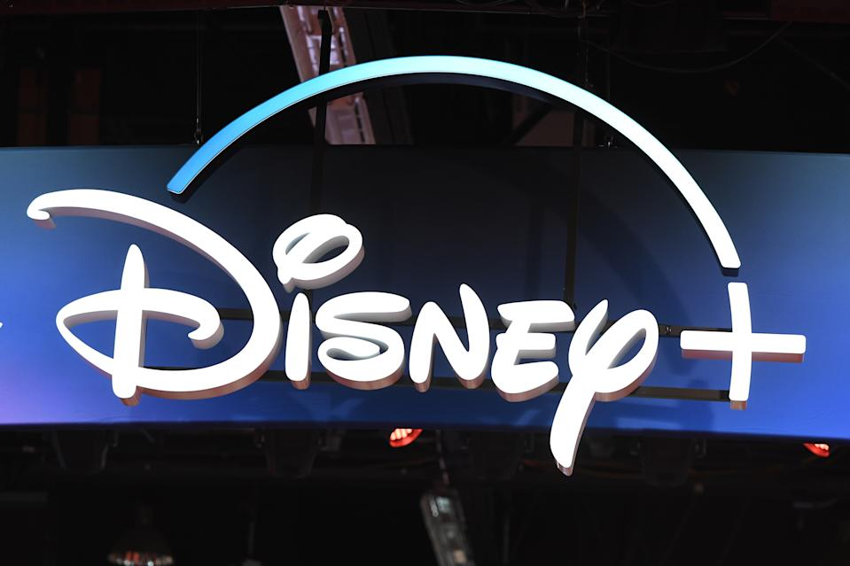 "A Disney+ streaming service sign is pictured at the D23 Expo, billed as the ""largest Disney fan event in the world,"" on August 23, 2019 at the Anaheim Convention Center in Anaheim, California. - Disney Plus will launch on November 12 and will compete with out streaming services such as Netflix, Amazon, HBO Now and soon Apple TV Plus. (Photo by Robyn Beck / AFP)        (Photo credit should read ROBYN BECK/AFP/Getty Images)"