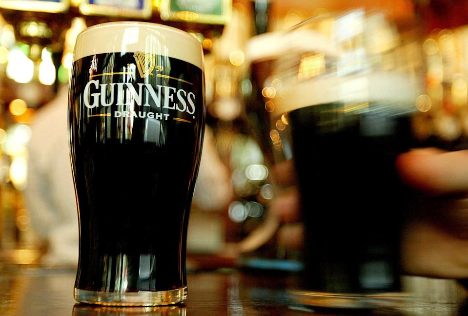 Pints of Guinness are seen in a London pub