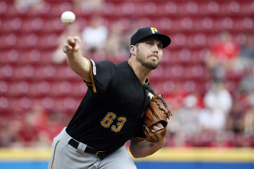 Pittsburgh Pirates starting pitcher Alex McRae throws in the first inning of a baseball game against the Cincinnati Reds, Monday, July 29, 2019, in Cincinnati. (AP Photo/John Minchillo)