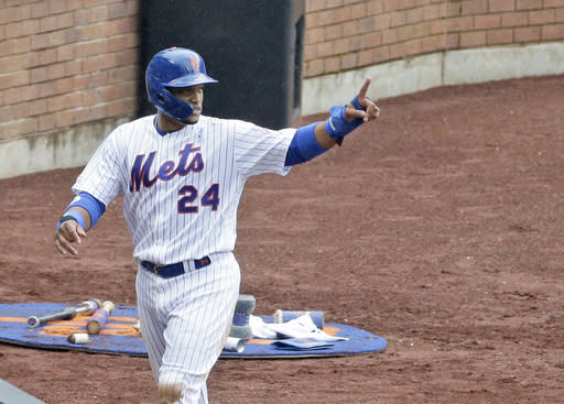 New York Mets Robinson Cano reacts after scoring on a single hit by Adeiny Hechavarria during the third inning of a baseball game against the St. Louis Cardinals at Citi Field, Sunday, June 16, 2019, in New York. (AP Photo/Seth Wenig)