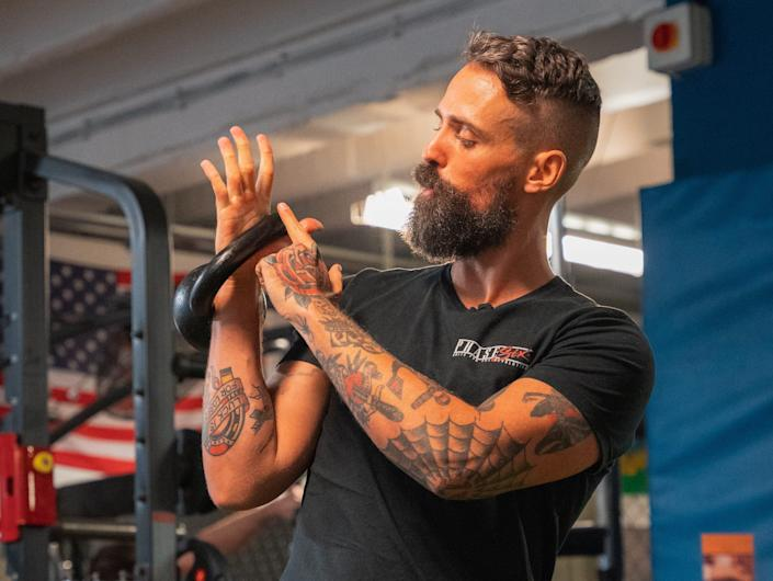 Jay Rose demonstrating the angle to hold a kettlebell.