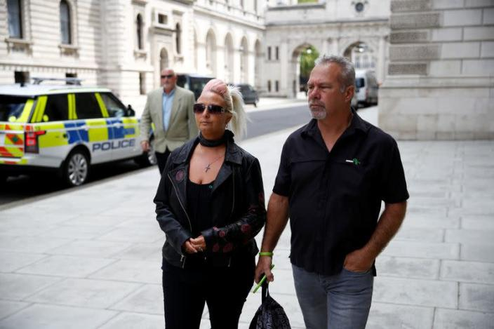 Charlotte Charles, mother of Harry Dunn, and Dunn's stepfather Bruce Charles walk outside the Foreign and Commonwealth Office in London