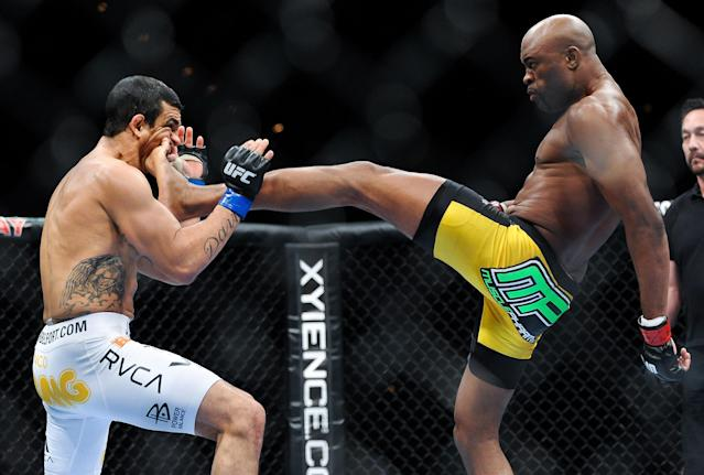 LAS VEGAS, NV - FEBRUARY 05: (R-L) Anderson Silva lands a kick to the jaw of Vitor Belfort that knocked out the Brazilian challenger at UFC 126 at the Mandalay Bay Resort and Casino on February 5, 2011 in Las Vegas, Nevada. (Photo by James Law/Zuffa LLC/Zuffa LLC via Getty Images)