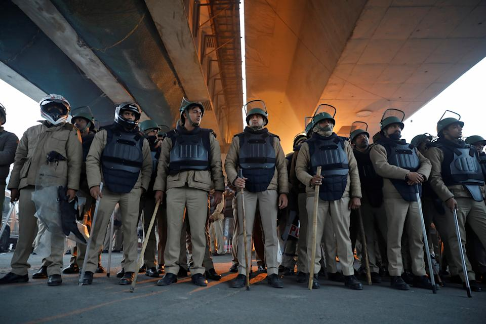 Police in riot gear keep watch during a protest against a new citizenship law, in Seelampur area of Delhi, India, December 20, 2019. REUTERS/Danish Siddiqui