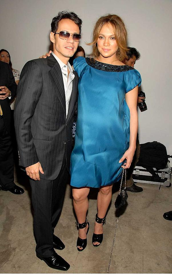 "A very pregnant Jennifer Lopez and husband Marc Anthony attended the Marchesa Fall 2008 fashion show at the Chelsea Art Museum on Wednesday. Jennifer's father David told Escandalo TV that she's expecting twins, though the mom-to-be is still keeping mum. Theo Wargo/<a href=""http://www.wireimage.com"" target=""new"">WireImage.com</a> - February 6, 2008"
