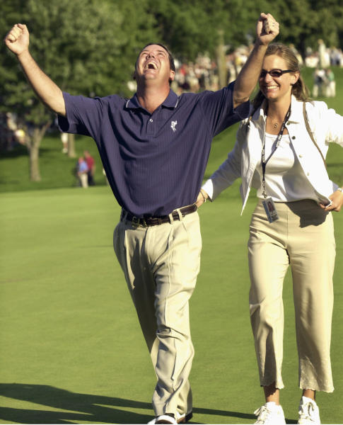 FILE - In this Aug. 18, 2002, file photo, Rich Beem celebrates on the 18th green with wife, Sara, after winning the 84th PGA Championship at Hazeltine National Golf Club in Chaska Minn. Hazeltine has a recent history of shockers, whether it was Rich Beem or Y.E. Yang winning the PGA Championship or the Americans winning the Ryder Cup. Now it hosts the Women's PGA Championship, a major that is rising to the top with the courses it plays. (AP Photo/Ann Heisenfelt, File)