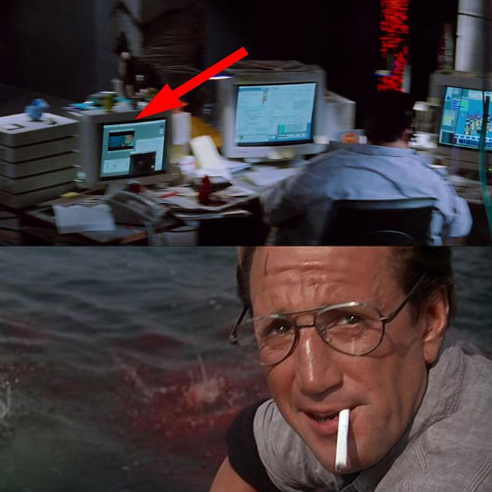 "Dennis Nedry can be seen watching ""Jaws"" on one of his computer monitors."