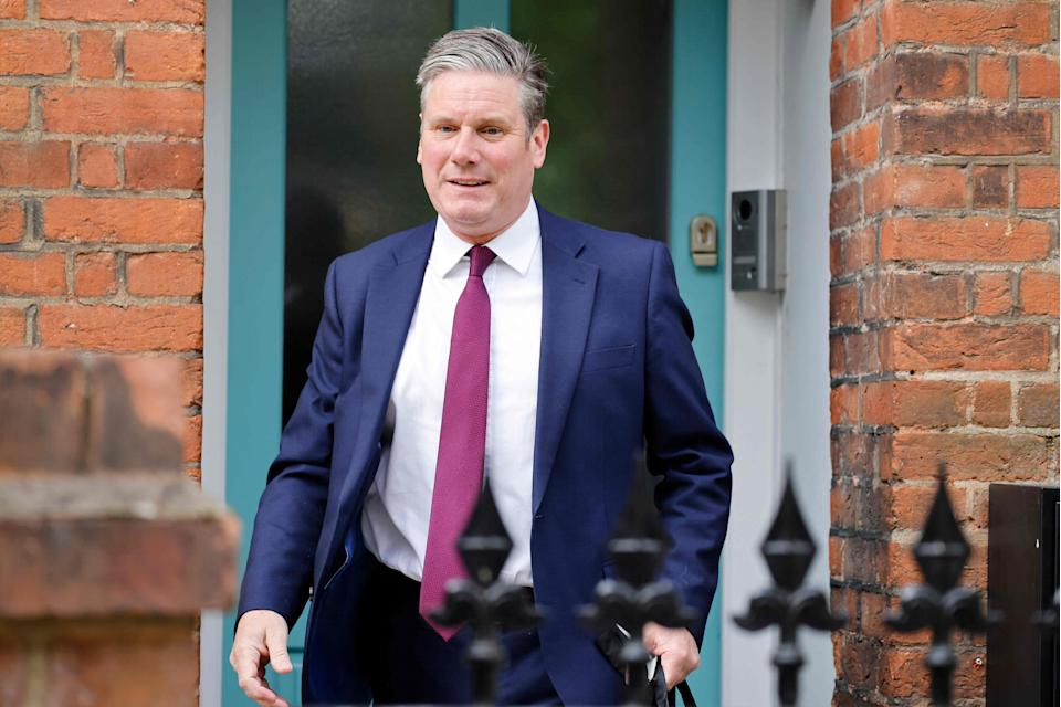 <p>Labour leader Keir Starmer leaves his home in North London</p> (AFP via Getty Images)