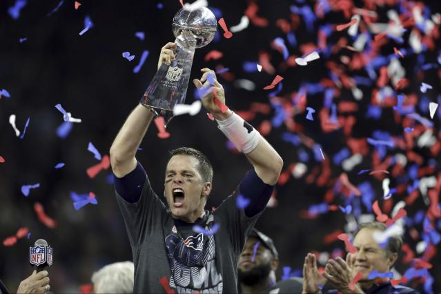 FILE - In this Feb. 5, 2017, file photo, New England Patriots' Tom Brady raises the Vince Lombardi Trophy after defeating the Atlanta Falcons in overtime at the NFL Super Bowl 51 football game in Houston. Bradys journey to each of his nine Super Bowls with the New England Patriots will be the subject of an ESPN series released in 2021. Entitled The Man in the Arena: Tom Brady, the nine-episode series will include a look from Bradys perspective at the six NFL titles and three Super Bowl defeats he was a part of. (AP Photo/Darron Cummings, File)