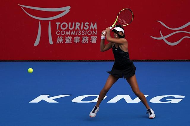 Lizette Cabrera of Australia hits a shot against Daria Gavrilova of Australia during their women's singles quarter-final tennis match at the Hong Kong Open tournament on October 13, 2017 (AFP Photo/Anthony WALLACE)