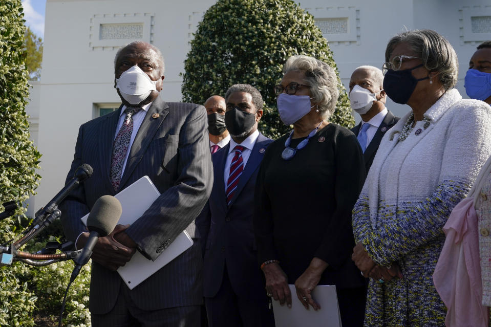 House Majority Whip James Clyburn, of S.C., left, speaks with members of the press alongside members of the Congressional Black Caucus after meeting with President Joe Biden and Vice President Kamala Harris at the White House, Tuesday, April 13, 2021, in Washington. (AP Photo/Patrick Semansky)