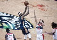 New Orleans Pelicans forward Brandon Ingram (14) shoots over Washington Wizards guard Raul Neto (19) in the third quarter of an NBA basketball game in New Orleans, Wednesday, Jan. 27, 2021. (AP Photo/Derick Hingle)