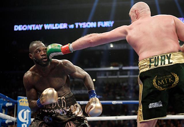 Tyson Fury connects with Deontay Wilder during their WBC heavyweight championship boxing match, Saturday, Dec. 1, 2018, in Los Angeles. (AP Photo)