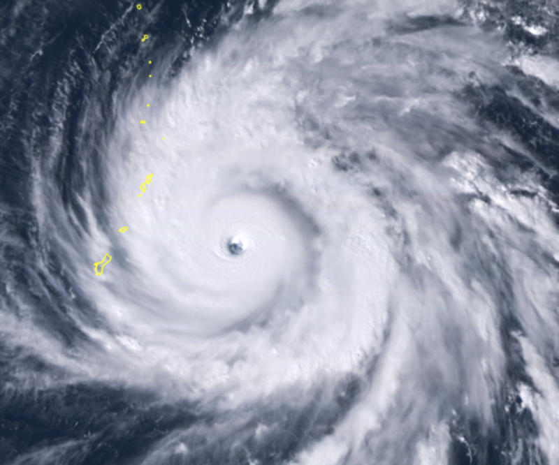A satellite image shows Typhoon Yutu east of Guam, set to cross over the U.S. commonwealth of the Northern Mariana Islands with damaging winds. (ASSOCIATED PRESS)