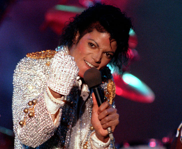 """FILE - In this Dec. 3, 1984 photo, Michael Jackson performs with his brothers at Dodger Stadium in Los Angeles, as part of their Victory Tour concert. Jackson's earning potential may become an issue when a Los Angeles jury begins deliberating a negligent hiring lawsuit filed by the singer's mother, Katherine Jackson, against concert giant AEG Live LLC over her son's 2009 death. Witnesses have testified throughout the 21-week trial that the pop superstar was planning a new career in movies after completing his """"This Is It"""" tour that was scheduled to begin in July 2009. (AP Photo/Doug Pizac, file)"""