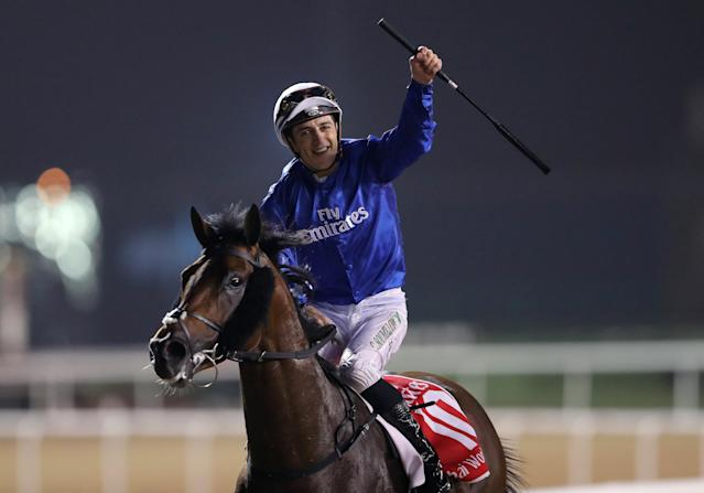 Horse Racing - Dubai World Cup 2018 - Meydan Racecourse, Dubai - United Arab Emirates - March 31, 2018 - Christophe Soumillon riding Thunder Snow from Ireland celebrates after winning the Final Race. REUTERS/Ahmed Jadallah