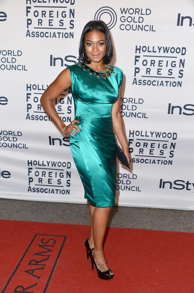 """WORST: We're happy to see the beautiful former """"Fresh Prince"""" star Tatyana Ali step into the spotlight at the 13th Annual InStyle And The Hollywood Foreign Press party at TIFF. We're not so happy to see her in this way-too-shiny teal frock, though. Maybe it's not so bad in dimmer lighting?"""