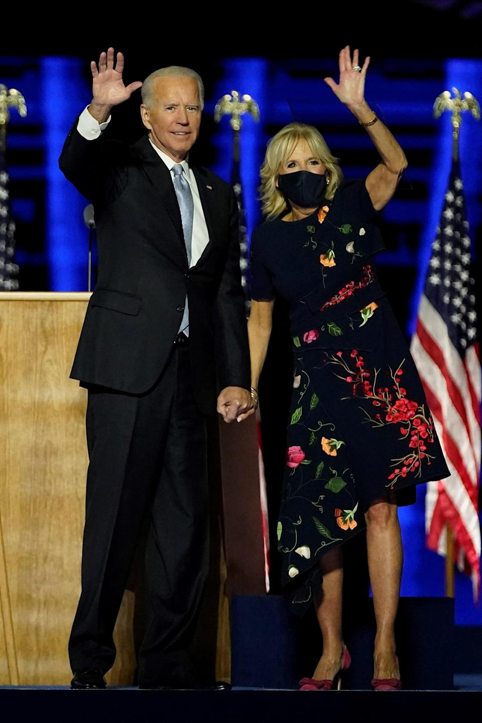 """<p>Dr. Biden chose an asymmetrical Oscar de la Renta dress to salute the crowd on stage with Joe when he delivered remarks in Delaware after being declared the <a href=""""https://www.popsugar.com/news/joe-biden-wins-2020-presidential-election-47947450"""" class=""""link rapid-noclick-resp"""" rel=""""nofollow noopener"""" target=""""_blank"""" data-ylk=""""slk:winner of the US presidential election"""">winner of the US presidential election</a>. Oscar de la Renta is a brand worn by many first ladies past, and it's worth mentioning that the late designer was born in the Dominican Republic before eventually launching his namesake label in the US. Now, co-creative directors Laura Kim and Fernando Garcia, who also founded New York-based brand Monse, are at the helm of Oscar de la Renta. They, too, are immigrants to the US.</p>"""