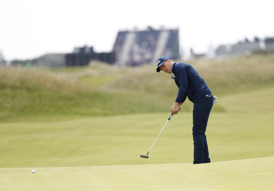 United States' Jordan Spieth putts on the 9th green during the first round British Open Golf Championship at Royal St George's golf course Sandwich, England, Thursday, July 15, 2021. (AP Photo/Peter Morrison)