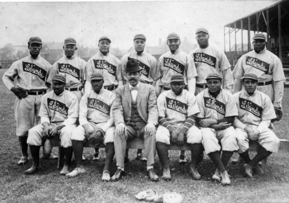 Team portrait of the Chicago Leland Giants baseball team, of the Negro League, with manager and owner Frank Leland (seated center, in the business suit), Chicago, Illinois, 1907. Among those also pictured are Rube Foster (standing far right) and Pete Hill (standing far left). (Photo by Transcendental Graphics/Getty Images)