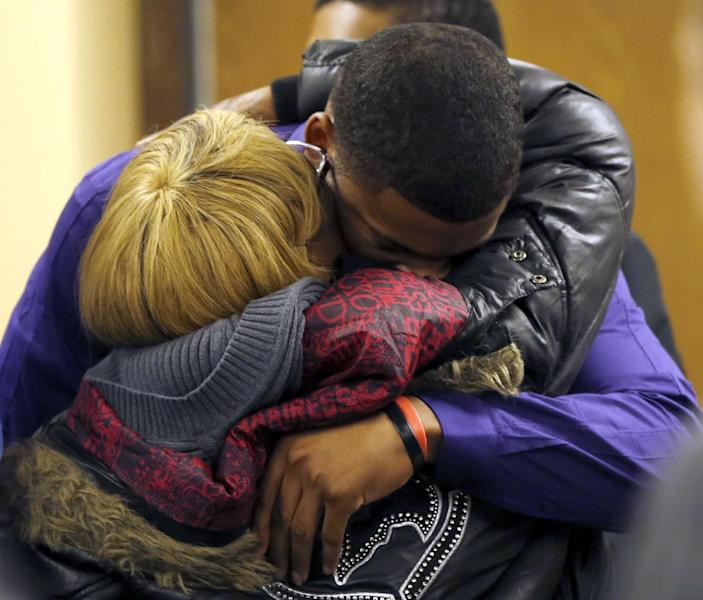 Ma'lik Richmond, 16, top, hugs his mother Daphne Birden, after closing arguments were made on the fourth day of the juvenile trial he and co-defendant Trent Mays, 17, on rape charges in juvenile court on Saturday, March 16, 2013 in Steubenville, Ohio. Mays and Richmond are accused of raping a 16-year-old West Virginia girl in August, 2012. Judge Thomas Lipps said he would render a decision on Sunday morning, March 17. (AP Photo/Keith Srakocic, Pool)