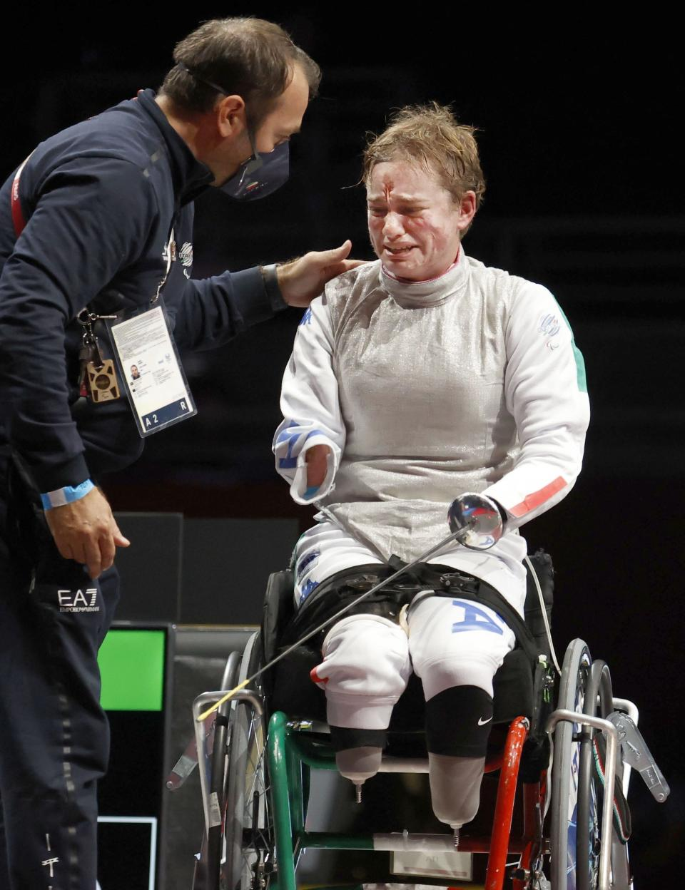 Italy's Beatrice Maria Vio celebrates after winning over China's Zhou Jingjing during their the wheelchair fencing women's foil Individual category B gold medal match in Chiba, near Tokyo, at the Tokyo 2020 Paralympic Games, Saturday, Aug. 28, 2021, in Tokyo, Japan. (Kyodo News via AP)