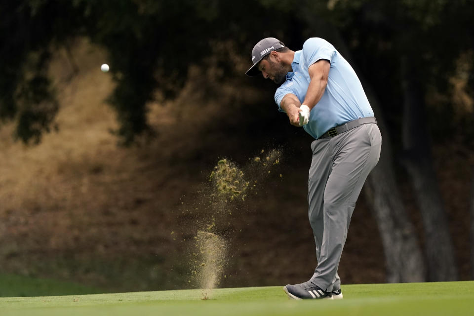 Jon Rahm hits from the 18th fairway during the third round of the Zozo Championship golf tournament Saturday, Oct. 24, 2020, in Thousand Oaks, Calif. (AP Photo/Marcio Jose Sanchez)