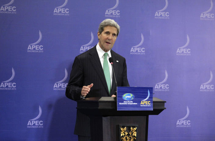 """U.S. Secretary of State John Kerry speaks during a press conference at the Asia-Pacific Economic Cooperation (APEC) ministers meeting in Bali, Indonesia, Saturday, Oct. 5, 2013. Kerry on Saturday urged Congress to end the partial government shutdown and think """"long and hard"""" about the message U.S. sends the world when """"we can't get our own act together."""" (AP Photo/Wong Maye-E)"""
