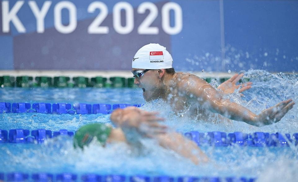 Singapore swimmer Joseph Schooling trailing during his men's 100m butterfly heat at the 2020 Tokyo Olympics.