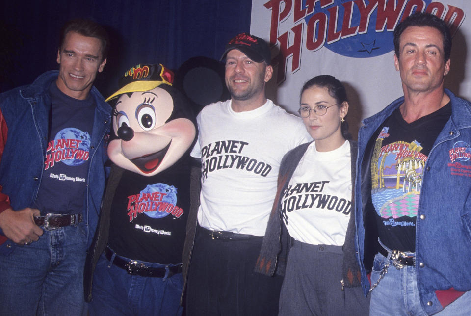 ORLANDO, FL - DECEMBER 17:   Actor Arnold Schwarzenegger, actor Bruce Willis, actress Demi Moore and actor Sylvester Stallone attend the Planet Hollywood Grand Opening Celebration on December 17, 1994 at Planet Hollywood, Pleasure Island, Disney World Resort in Orlando, Florida. (Photo by Ron Galella, Ltd./Ron Galella Collection via Getty Images)