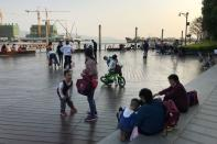 Children play at a waterfront in Shekou area of Shenzhen