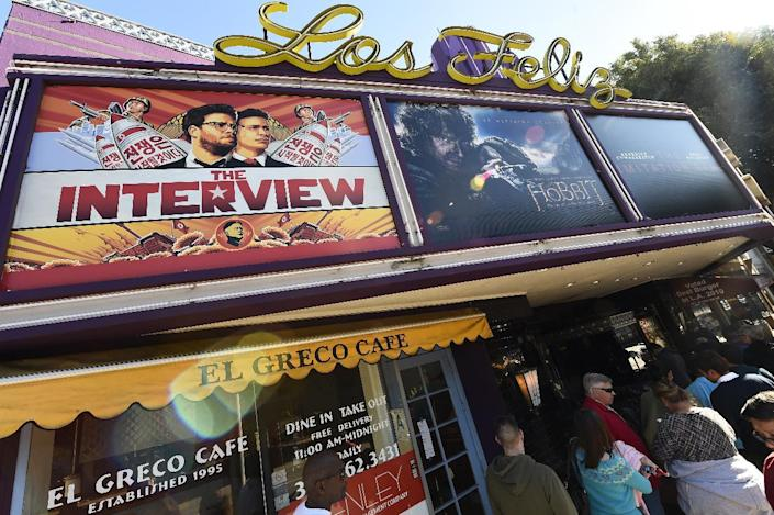 """Movie-goers wait in line outside the Los Feliz 3 Cinema in Los Angeles, California on December 25, 2014 to purchase tickets for the """"The Interview"""" (AFP Photo/Robyn Beck)"""